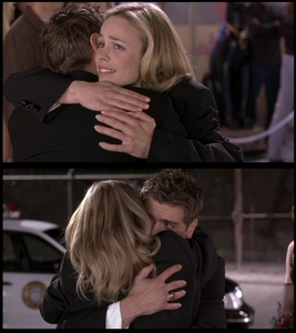 Matthew and Rachel holding each other 由 hugging <33333