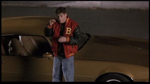 Matthew standing par a 78' Pontiac car. <3333