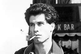 John with a cigarette in his mouth while looking serious :)