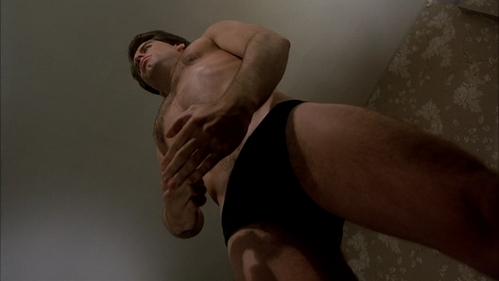 John wearing black undies while looking under him <333