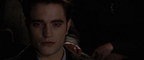 my sexy brooding vampire Edward in a dark movie theater<3