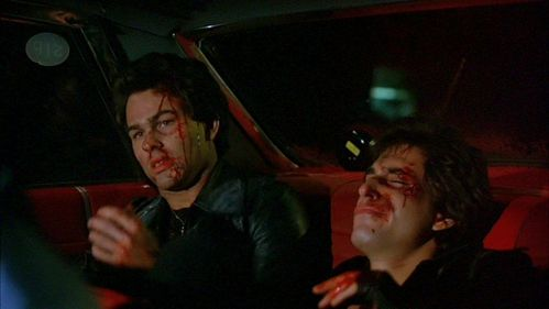 Both of John's co stars, Paul Pape (left) and Joey Cali (right) with bloody faces.