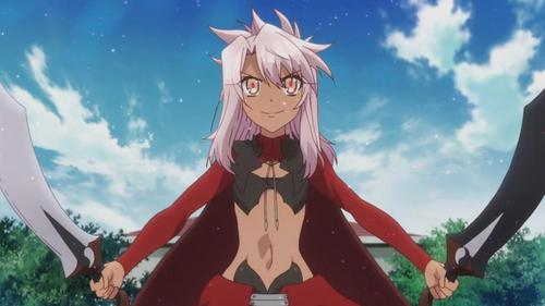 Kuro from Fate/kaleid liner Prisma Illya. Hair color is a bit off, but she's short, tan, and has long hair. Since she's a new character in a 表示する that's coming out right now, she might not be very well known though.