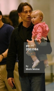 Bobby holding his daughter Ava