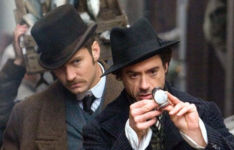 Jude Law and RDJ wearing hats<3