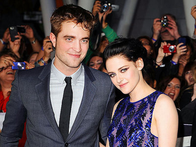 my 2 fave people,Robert and Kristen,with people in the background<3