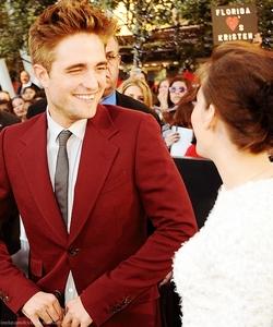 Robert smiling at the lovely Kristen Stewart<3<3