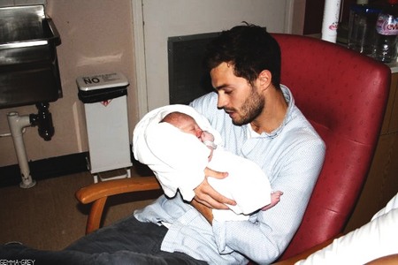 Jamie looking at his baby girl<3