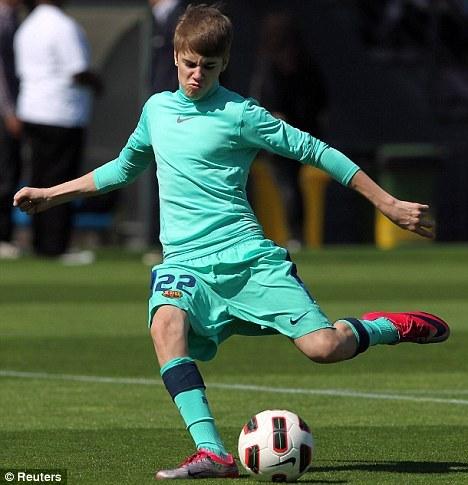 Jb playing football<3