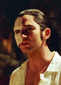 Gerard Butler as the Phantom of the Opera wearing a mask<3