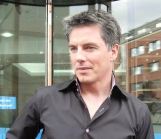 John Barrowman if he had a hair full of grey :)