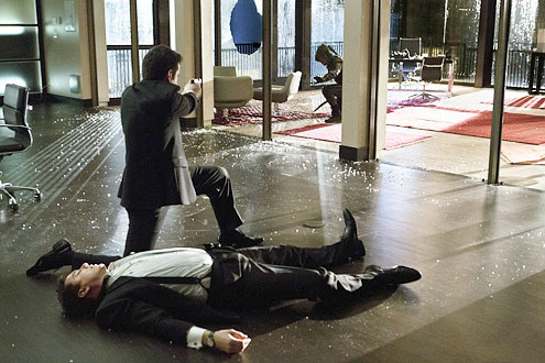 John Barrowman (Malcolm Merlyn) on the floor with Colin (Tommy Merlyn) pointing a gun at Stephen (Green Arrow)