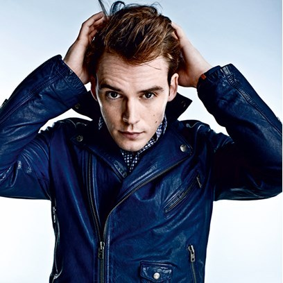 Sam wearing a cool blue leather jacket<3