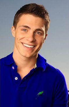 Colton in a deep blue shirt<3