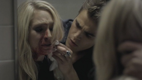 Candice Accola as Caroline Forbes with blood on her face from The Vampire diaries with co-star Paul Wesley as Stefan Salvatore