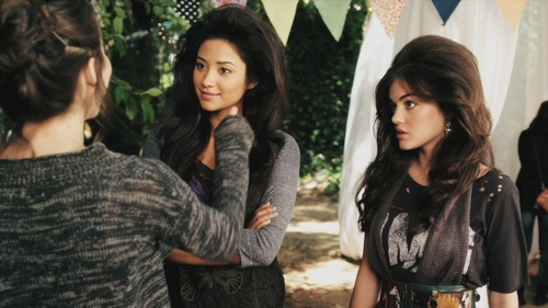 Lucy Hale as Aria Montgomery and her co-star Shay Mitchell who plays Emily Feilds in Pretty Little liars