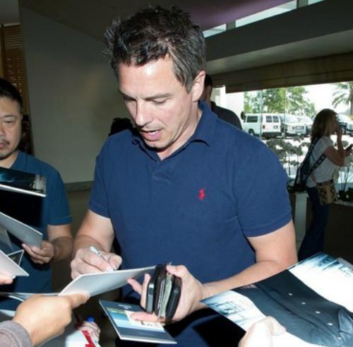 John signing autographs :D