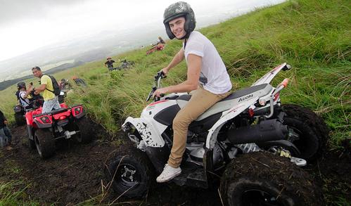 Zac riding an ATV<3