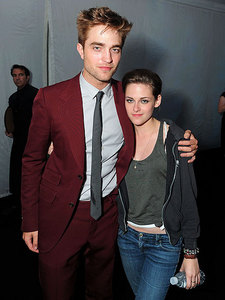 Kristen with her tall British beau<3