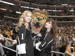 Here they r at a Kings game.
