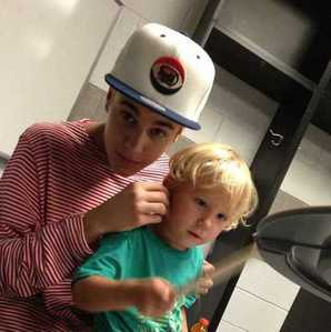 Justin with his little brother,Jaxon,who isn't as known as Justin...yet<3