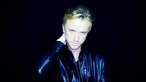 Tom Felton in a blue leather jacket<3