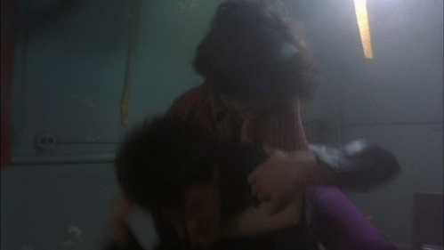 A blurred pic of a woman jumping on Paul's back during the gang fight.