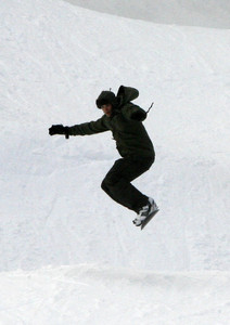 Kellan snowboarding in the snow<3