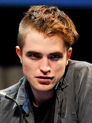 Robert with a crazy half shaved head(which was for a movie)<3