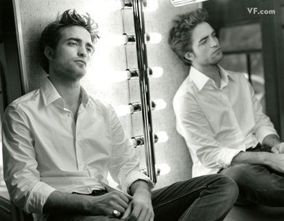 my sexy Robert leaning against a mirror<3