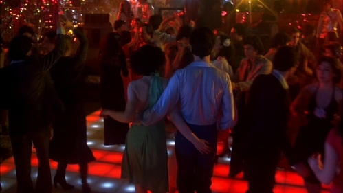 John walking to the dance floor with Fran Drescher with her hand on his tush :)