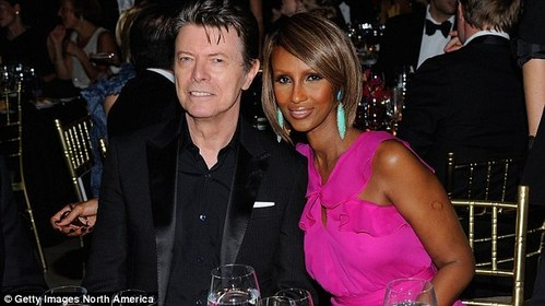 David with his wife,Iman.Wrinkles make him look very distinguished<3