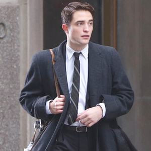 Robert with his hair slicked and slightly parted<3
