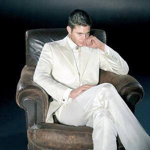Jensen in a white suit