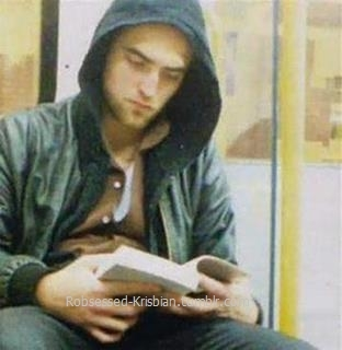 my handsome babe seems to be into that book he's reading<3
