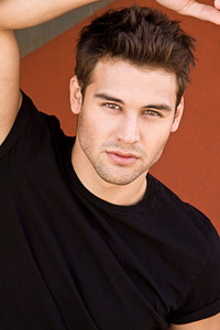 Ryan G in a dark colored t-shirt<3