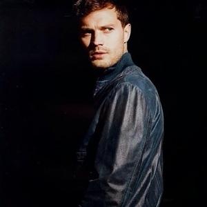Jamie with a dark background<3