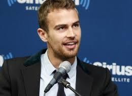 gorgeous Theo with a mike in front of him<3