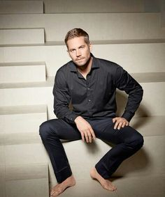 Paul Walker sitting on a step<3