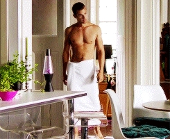 Theo with a white towel around his waist<3