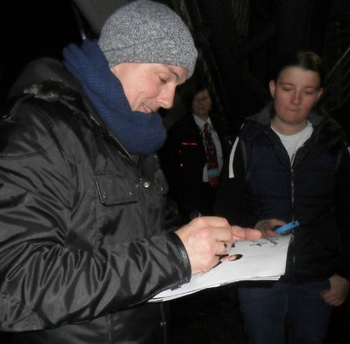 John signing my picture with me in the background :D