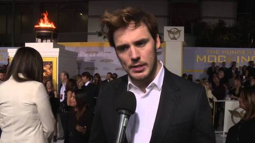 Sam Claflin being interviewed at the Mockingjay part 1 premiere<3