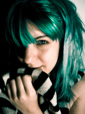 Green hair! I don't know who she is but it looks cool.