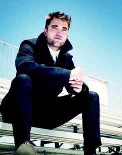 """Robert is very tall,he's 6'1"""",but he's not at his full height in this pic,because he's sitting down<3"""