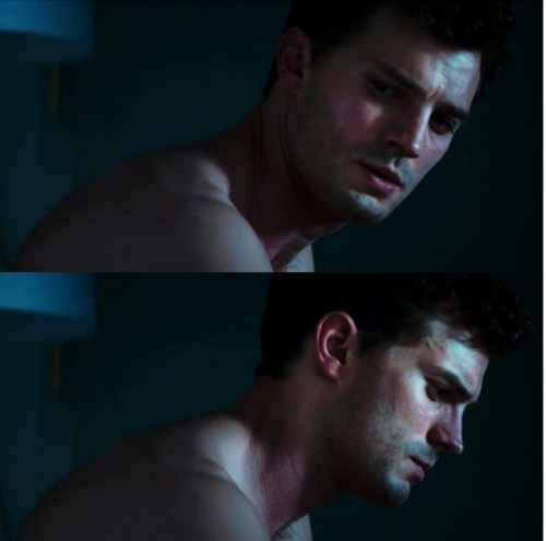 Jamie in a scene from FSOG looking down<3