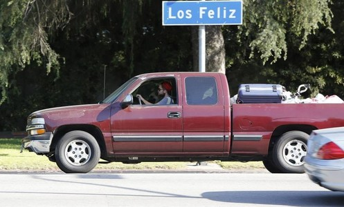 my babe driving with a sign above his truck<3
