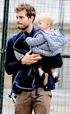 Jamie holding his baby girl<3