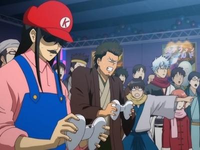 Katsura & Kondo (Gintama)   Katsura & Kondo playing Owee (video game) batling each other.........this was one funny episode........love Katsura........he he he eh