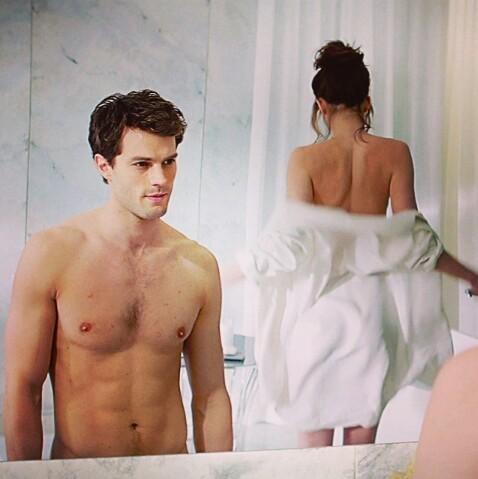 Jamie looking at Dakota in a scene from FSOG<3