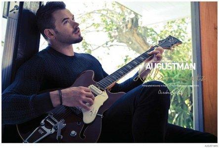 Kellan using his hands playing guitar<3